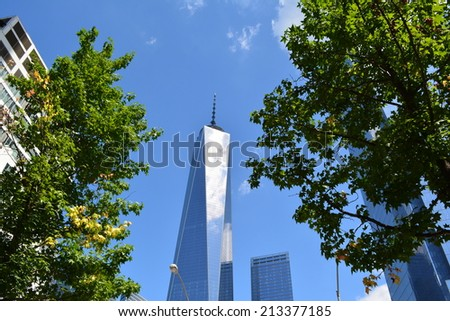 New York City, USA - August 24, 2014: View of the nearly completed World Trade Center Tower One at Ground Zero in New York City.  - stock photo