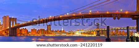 New York City, USA. Brooklyn and Manhattan bridges at sunset with colorful lights - stock photo