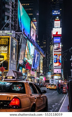 NEW YORK CITY, USA - CIRCA SEPTEMBER 2014: A busy night in Times Square, New York. Times Square is a famous landmark in midtown Manhattan with bright billboards and advertisements.