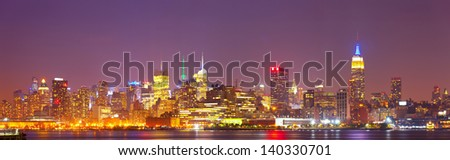 New York City, USA colorful night skyline panorama with illuminated landmark buildings in downtown Manhattan business and residential districts - stock photo