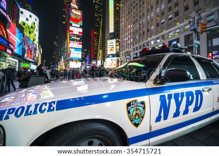 NEW YORK CITY, USA - DECEMBER 22, 2015: NYPD police car stands parked in Times Square as a security precaution in the lead-up to New Year's Eve. - stock photo