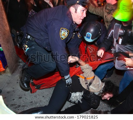 NEW YORK CITY, USA - DECEMBER 17 2011: Occupy Wall Street, protesting financial malfeasance, marked its 90 day anniversary with marches in Manhattan.  NYPD arresting protestors in Midtown Manhattan. - stock photo