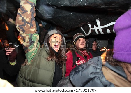NEW YORK CITY, USA - DECEMBER 17 2011: Occupy Wall Street, protesting financial malfeasance, marked its 90 day anniversary with marches in Manhattan. Marching uptown. - stock photo