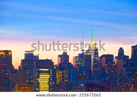 New York City, USA. detail of Downtown buildings in Manhattan with colorful lights, panorama at sunset