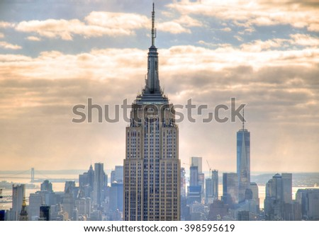 NEW YORK CITY, USA, FEB 5, 2016:Two of the most famous skyscrapers in New York City: The Empire State Building and The Freedom Tower  with the background of Downtown Manhattan skyline before sunset - stock photo