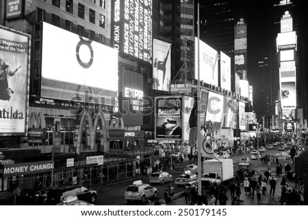New York City, USA - February 1st, 2015: Times Square is a major commercial intersection and a neighborhood in Midtown Manhattan, New York City.  Black and white photo. - stock photo
