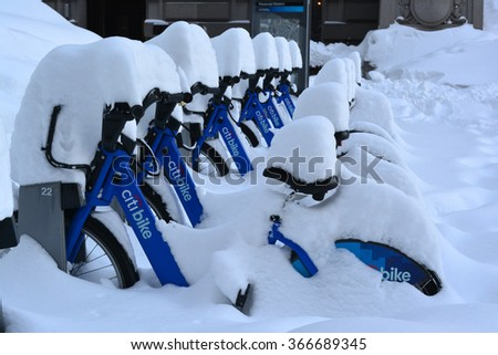 New York City, USA - January 24, 2016: Citi Bikes covered in snow in Lower Manhattan following the blizzard of 2016 in New York City. - stock photo