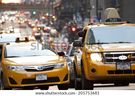 New York City, USA - July 11, 2014: Yellow taxi at 42nd street in New York City during afternoon. - stock photo
