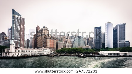 NEW YORK CITY, USA - 13 JUNE 2014: A Statue Cruises Tour Boat docks at Battery Park. Every day thousands of people visit this pier Liberty Island and Island Elys - stock photo