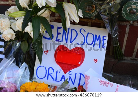 New York City, USA - June 13, 2016: Memorial outside the landmark Stonewall Inn for the victims of the mass shooting in Orlando in 2016 in New York City. - stock photo