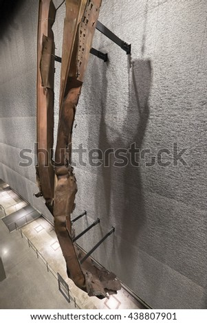 NEW YORK CITY, USA - JUNE 08 2016 - Remnants of Twisted Steel of the Twin Towers in the National 9/11 Memorial Museum at Ground Zero in Lower Manhattan, New York City, USA - stock photo