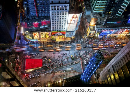 NEW YORK CITY, USA - JUNE 29th, 2014: Aerial view of Times Square the popular New Year's Eve destination with crowds and taxi cabs in motion in New York City. - stock photo
