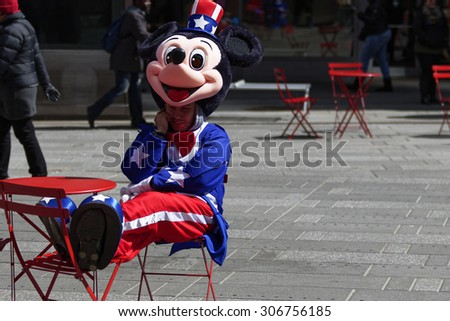 New York City, USA - March 18, 2015: Costumed street character performers on the streets of New York City on March 18, 2015. - stock photo