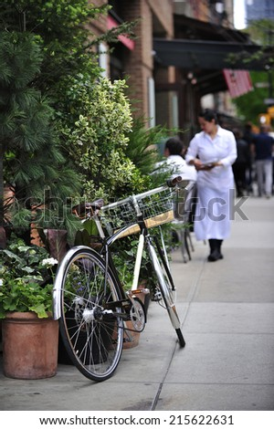 New York City, USA, - May. 18. 2014: Bike sitting by the outdoor cafe, Tribeca, New York, USA