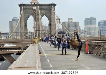 New York City, USA - May 23, 2014: Brooklyn bridge at dusk, New York City - stock photo