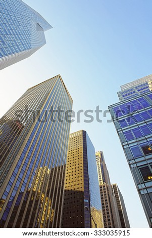 NEW YORK CITY, USA - MAY 7, 2015: Low angle view of skyscrapers in the Financial District of New York City, USA.          - stock photo