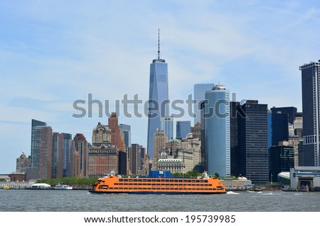 NEW YORK CITY, USA - May 26, 2014: Staten Island Ferry cruising in New York Harbor with the Lower Manhattan skyline in the background. - stock photo