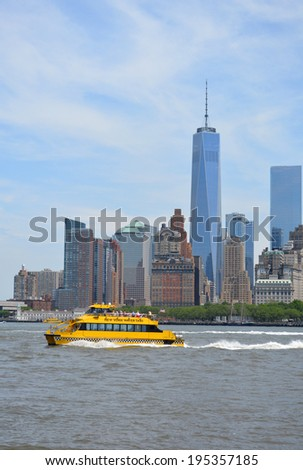 NEW YORK CITY, USA - May 26, 2014: Water taxi cruising through New York Harbor with the Lower Manhattan skyline in the background.  - stock photo