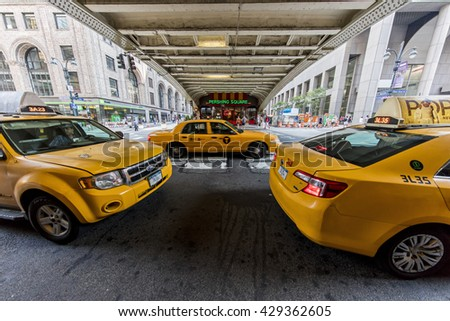 NEW YORK CITY, USA - May 28, 2016: Yellow taxi cabs in New York City wait outside Grand Central Terminal for customers. - stock photo