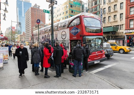 NEW YORK CITY, USA - NOVEMBER 20, 2014 : A tourist group is waiting for the bus tour in Manhattan New York City.