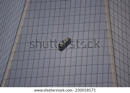 New York City, USA - November 12, 2014: Collapsed scaffolding with workers inside the basket dangling at World Trade Center Tower One at Ground Zero in New York City.  - stock photo