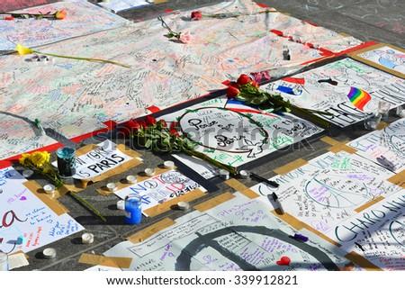 New York City, USA - November 16, 2015: Memorial following the terrorist attacks in Paris in Washington Square Park in New York City.  - stock photo