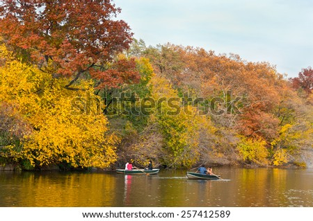 NEW YORK CITY, USA - NOVEMBER 14: People renting a rowboat and enjoying beautiful autumn day in Central Park at New York City at November 14, 2011. - stock photo