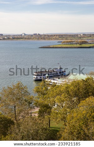 New York City, USA - November 4: View of the ferry connecting Manhattan, Ellis Island and Liberty Island near New York City, USA on November 4, 2014. - stock photo