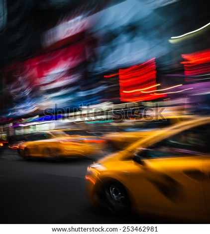 NEW YORK CITY, USA - OCT 11, 2014: Illumination and night lights on The Times Square at night in New York City. Times Square is major commercial intersection in New york. Image in motion blur style.   - stock photo