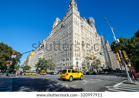 NEW YORK CITY, USA - OCT 13: Yellow taxi cabs on street on October 13,2012 in New York City.The taxicabs of New York City are widely recognized icons of the city,come in two varieties:yellow and green - stock photo