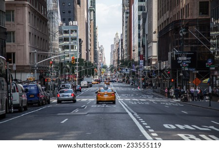 NEW YORK CITY, USA - OCTOBER, 2014: Few cars driving on Broadway in New York City - stock photo