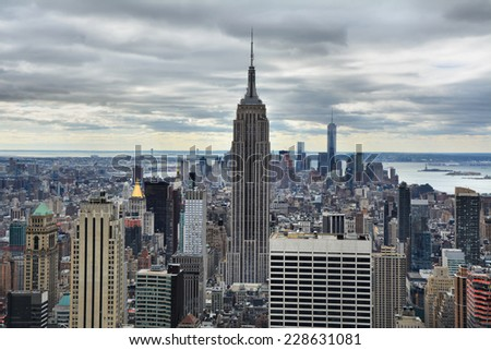 NEW YORK CITY, USA - OCTOBER 24, 2014:  Manhattan Midtown skyline on cloudy day. New York City is the cultural and financial capital of the world - stock photo