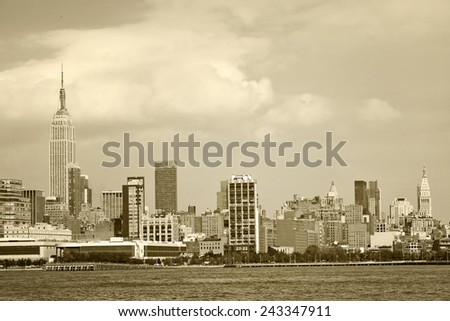 New York City, USA panorama of downtown landmark buildings and the river on a beautiful sunny day, desaturated sepia toning - stock photo