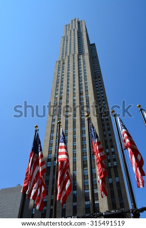 New York City, USA - September 7, 2015: Flags in front of 30 Rockefeller Center in honor of Labor Day in Midtown Manhattan in New York City. - stock photo
