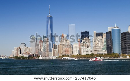NEW YORK CITY, USA - SEPTEMBER 27, 2014: New York panorama and One World Trade Center (formerly known as the Freedom Tower). Freedom Tower is shown finished with antenna. - stock photo