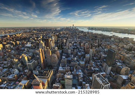 NEW YORK CITY, USA - SEPTEMBER 19: New York panorama and One World Trade Center (formerly known as the Freedom Tower) on September 19, 2012 in New York. Freedom Tower is shown under construction. - stock photo