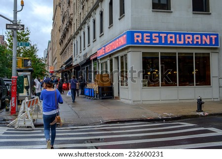 NEW YORK CITY, USA SEPTEMBER 25: Pedestrians pass Tom's Restaurant at 2880 Broadway on September 25, 2014 in NYC. This is the location for Suzanne Vegas Toms Diner and Seinfelds Monks Cafe. - stock photo