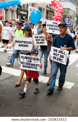 NEW YORK CITY, USA - SEPTEMBER, 2014: Protesters during the New York City Labor Day Parade 2014 - stock photo