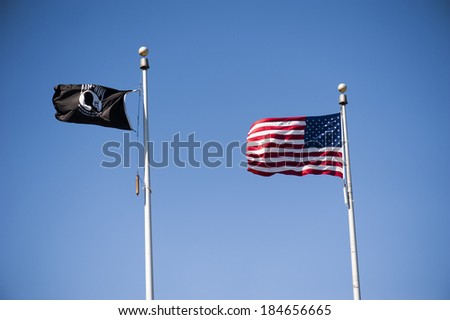 New York City, USA - September 15th, 2012. Missing in action flag with USA flag on wind