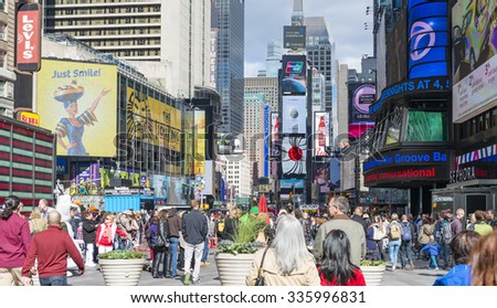 NEW YORK CITY,USA-SEPTEMBER 17,2015: Times Square a New York City attraction: famous and historic landmark visited by millions every year. Also known as the Crossroads of the World - stock photo