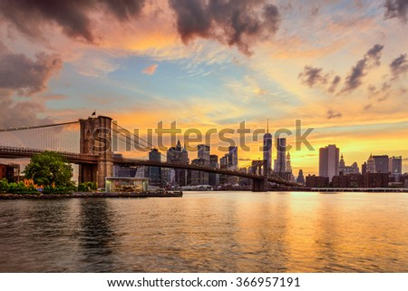 New York City, USA skyline from the East River and Brooklyn Bridge. - stock photo