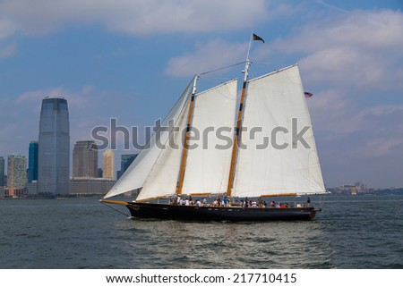 NEW YORK CITY, USA -  31ST AUGUST 2014: A boat sailing in the Hudson River near downtown New York City. People can be seen on the boat
