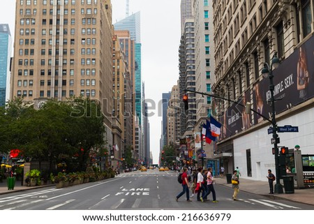 NEW YORK CITY, USA -  31ST AUGUST 2014: A view up sixth avenue in central Manhattan during the day. People and traffic can be seen on the street. - stock photo