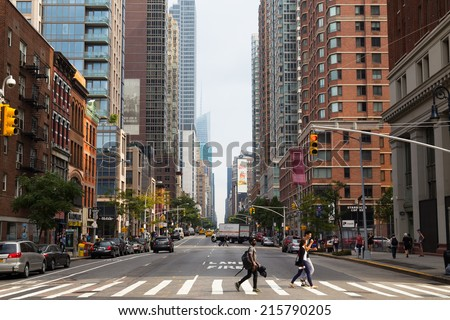 NEW YORK CITY, USA - 31ST AUGUST 2014: A view up Sixth Avenue in New York City during the day. People and Vehicles can be seen on the street - stock photo