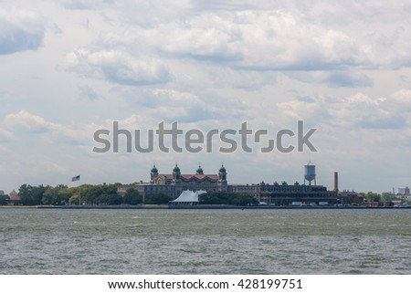New York City, USA - summer: Ellis Island, at the mouth of Hudson River in New York Harbor on a cloudy day