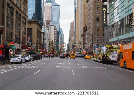 NEW YORK CITY, USA - 30TH AUGUST 2014: A view down Seventh Avenue towards Time Square, showing lots of traffic and people.