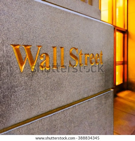 New York City Wall Street road sign in downtown Manhattan with skyscrapers. An entrance to an office building on Wall Street in New York City, USA. - stock photo