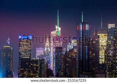 New York City with skyscrapers illuminated over Hudson River panorama - stock photo