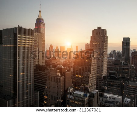 New York city with sunset across horizon - stock photo