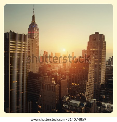 New York city with sunset across horizon with Instagram style filter - stock photo